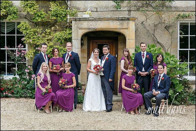 Stunning group photo taken at a quintessentially English wedding