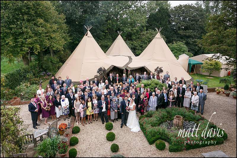 Wedding guests outside a wedding teepee in The Cotswolds