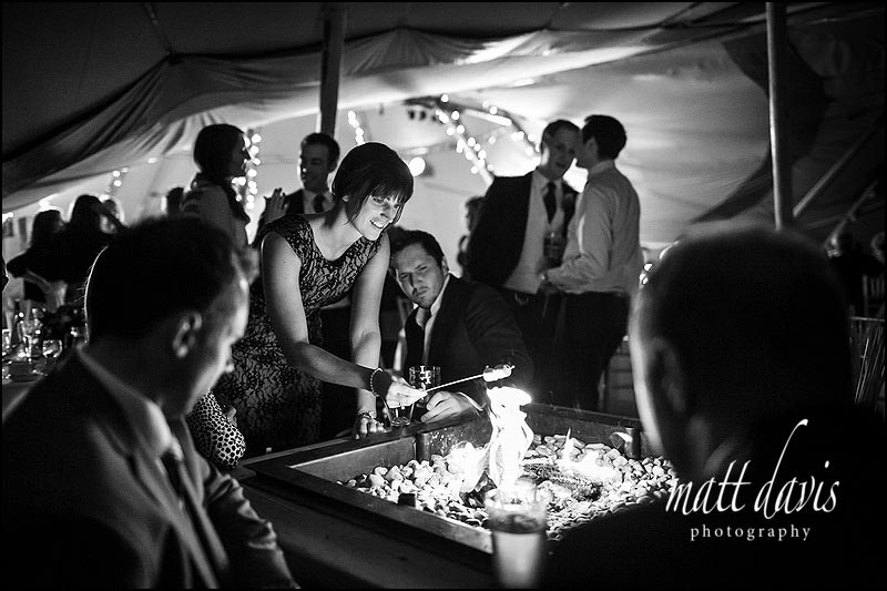 marsh mallow toasting over an open fire at a wedding