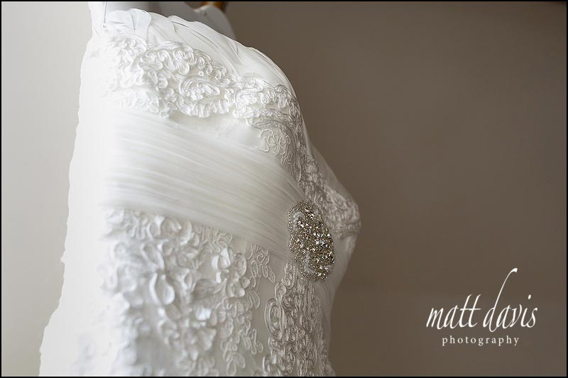 Ivory white wedding dress with feather detailing.