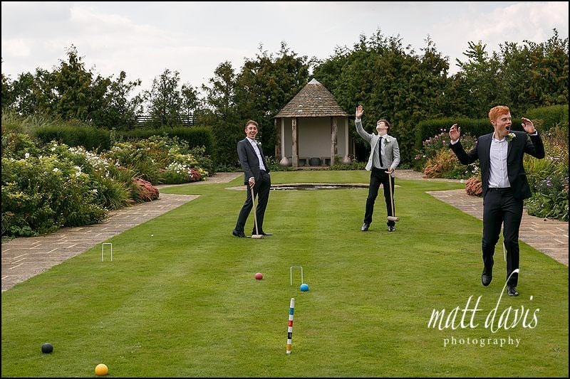 Wedding guests playing on the Croquet lawn and gardens at Whatley Manor