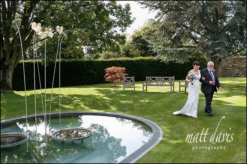 Whatley Manor wedding photography of brides arrival