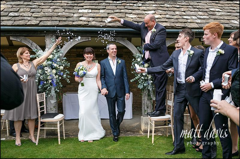Confetti being thrown at a Whatley Manor wedding
