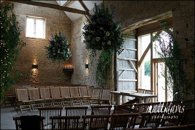 Inside Cripps Stone barn set for a wedding ceremony