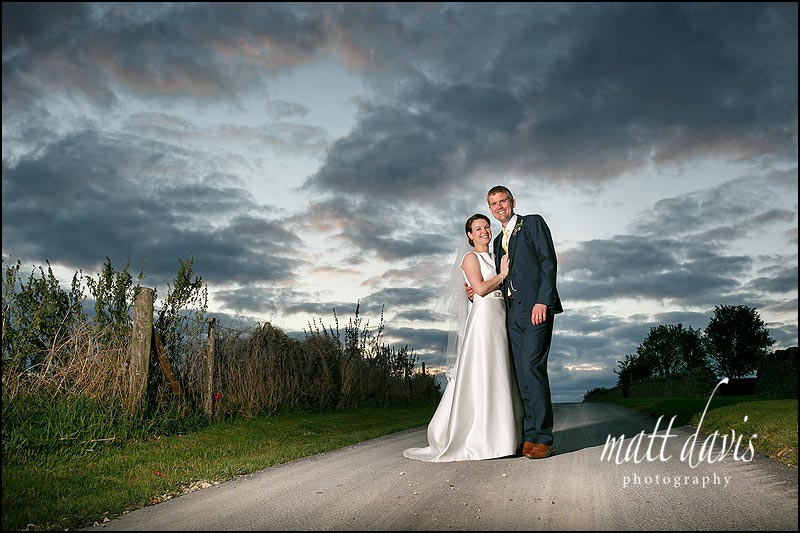 Dramatic couple portraits taken at a Cripps Stone Barn wedding