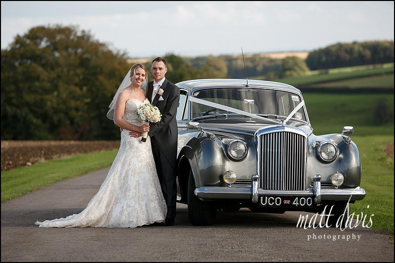 Vintage wedding car at Kingscote Barn