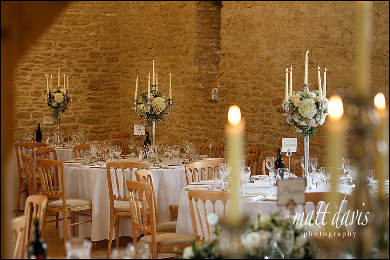 Candle arbors at an Autumnal wedding at Kingscote Barn