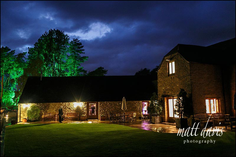 A warm but wet evening during an autumnal wedding at Kingscote Barn