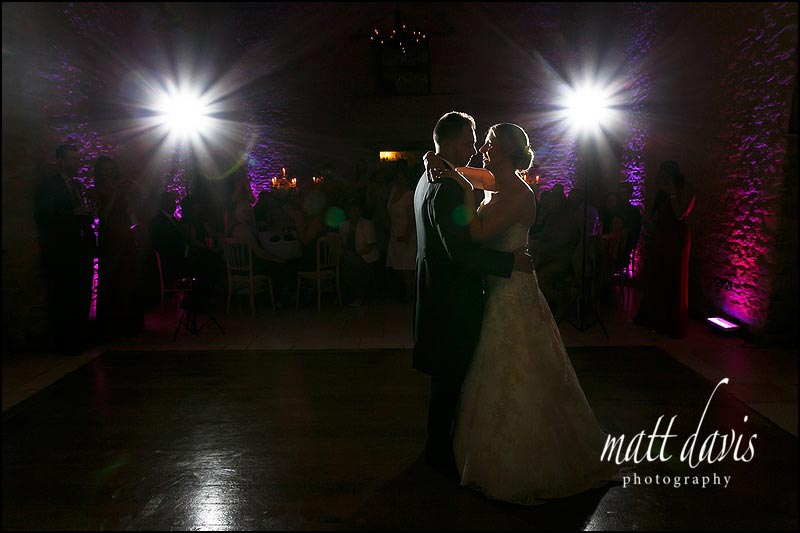 First dance during an autumnal wedding at Kingscote Barn