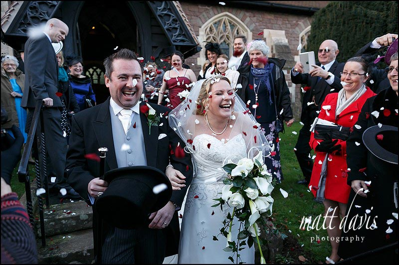 Wedding confetti being thrown at St Peter's Church Clearwell Gloucestershire