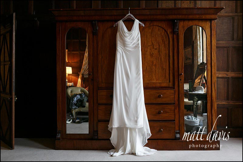 Wedding dress hung on wardrobe in bridal suite at Elmore Court