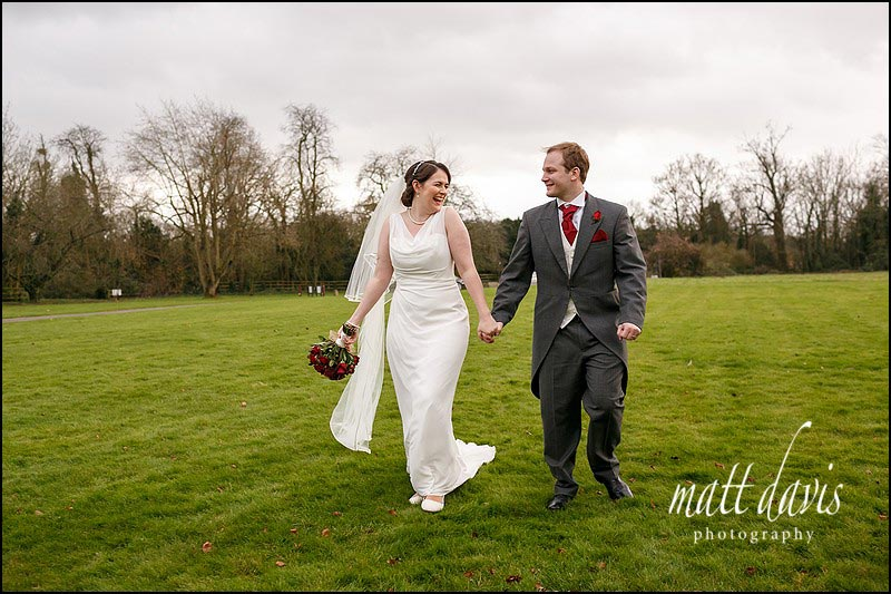 Natural wedding photos of couple on lawn at Elmore Court