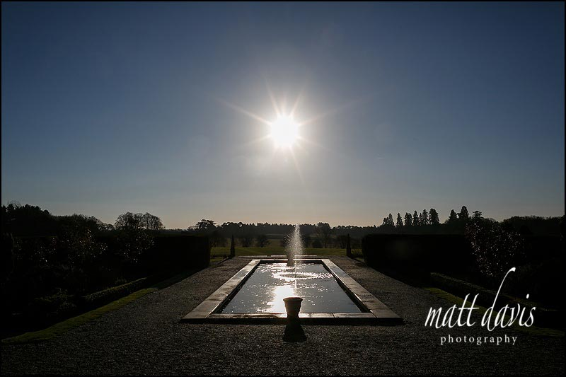 wedding photos outside in winter at Eynsham Hall
