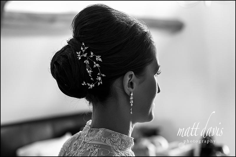 Stunning silver hair piece, earrings and Jenny Packham wedding dress