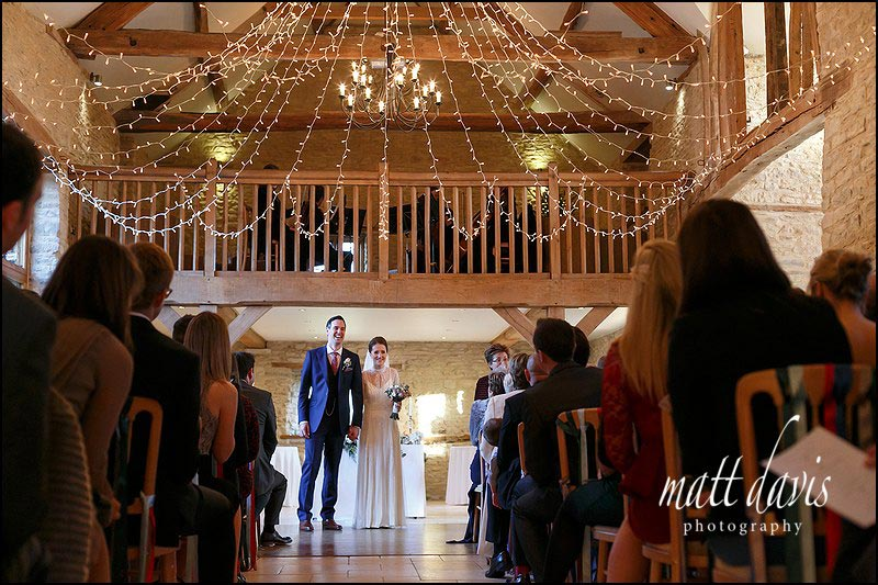 Kingscote Barn winter wedding ceremony with light canopy