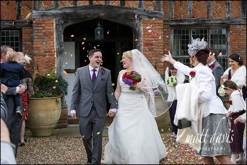 confetti being thrown during a wedding at Dorney Court