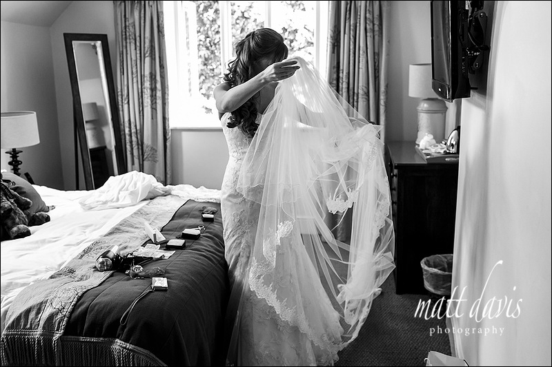 Documentary black and white wedding photos taken at Manor House Hotel Moreton-In-Marsh