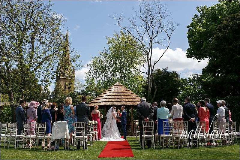 Outdoor wedding ceremony at Manor House Hotel Moreton-In-Marsh