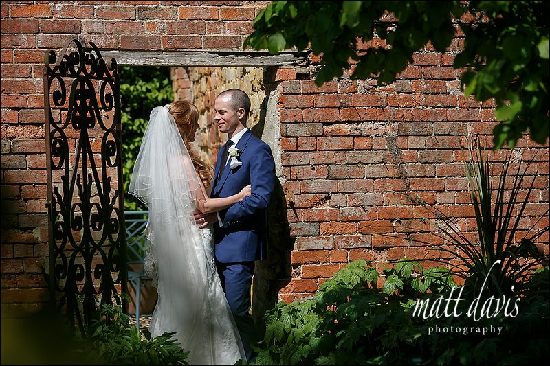 Relaxed couple wedding photos taken at Manor House Hotel Moreton-In-Marsh