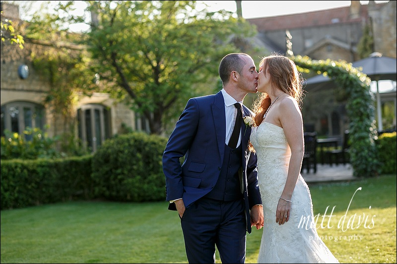 Married couple kiss at Manor House Hotel wedding