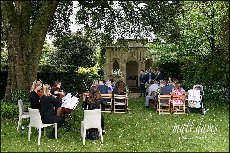 String quarter playing at a Garden wedding at Barnsley House Gloucestershire