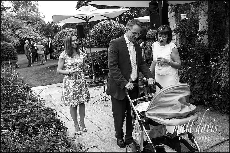 Black and white wedding photos taken at Barnsley House in Gloucestershire