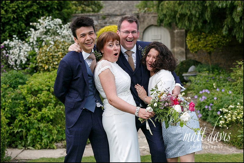 Fun group wedding photos taken in the garden at Barnsley House