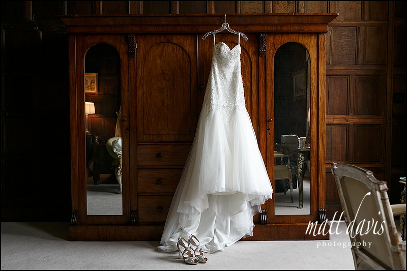 Wedding dress and shoes beautifully photographed at Elmore Court