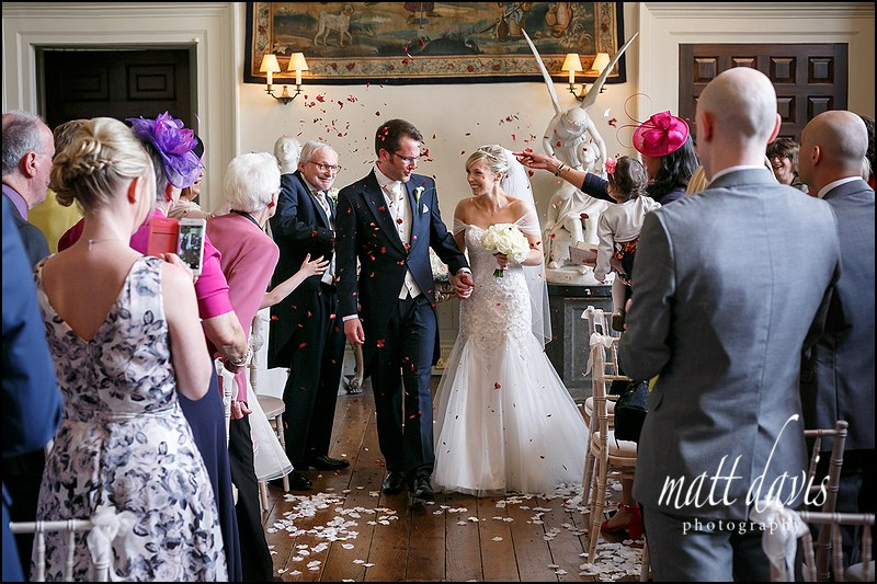 Confetti thrown during recessional at a wedding at Elmore Court