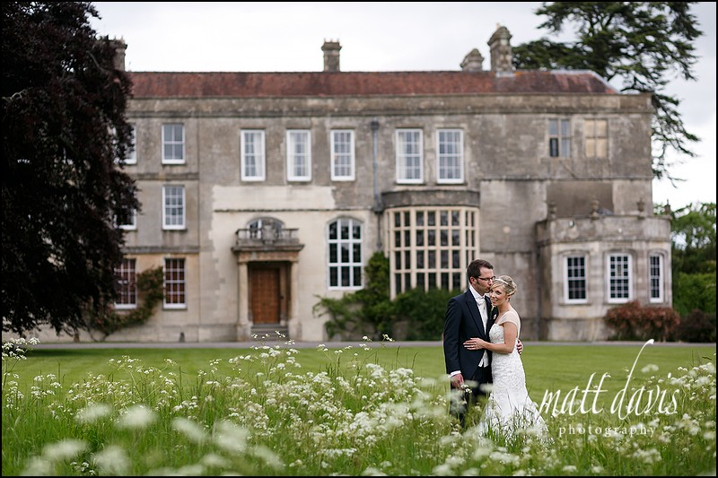 Loving wedding photos taken in the meadow at Elmore Court