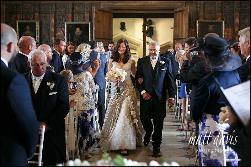 wedding photographer photographs brides entrance in the great hall at Berkeley Castle