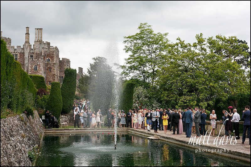by the fountain at Berkeley Castle for the wedding drinks reception