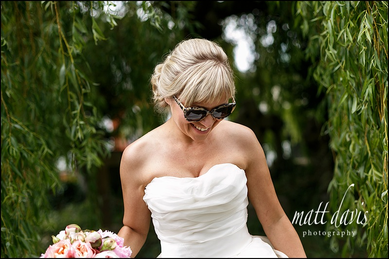 Ray Ban sunglasses, wedding dress and bouquet look amazing