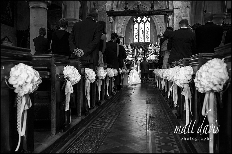 Black and white wedding photos at St Mary's Church Charlton Kings