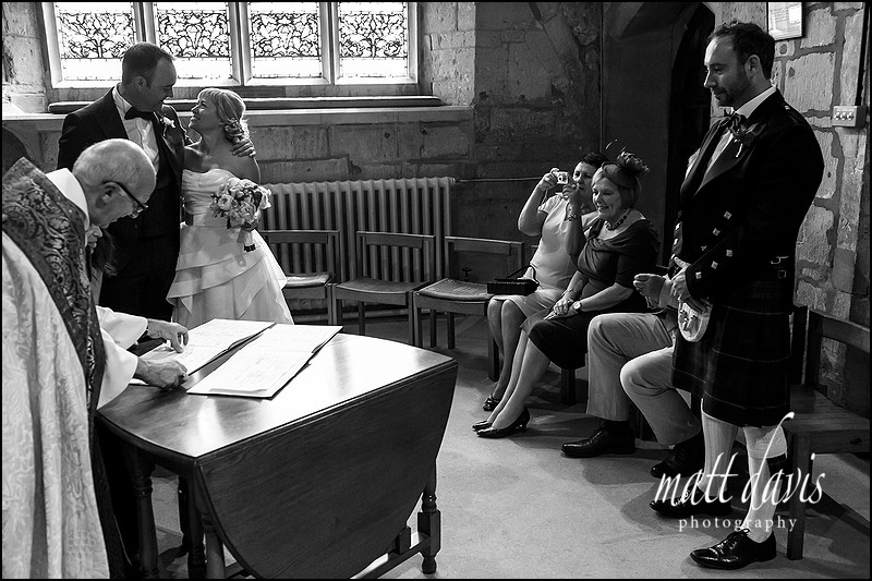 Documentary Black and white wedding photos at St Mary's Church Charlton Kings
