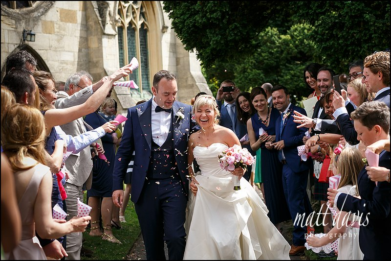 Confetti being thrown at St Mary's Church Charlton Kings, Cheltenham Gloucestershire