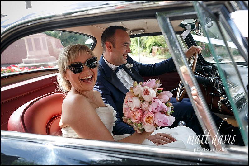 Rock and Roll bride in classic vintage sports car