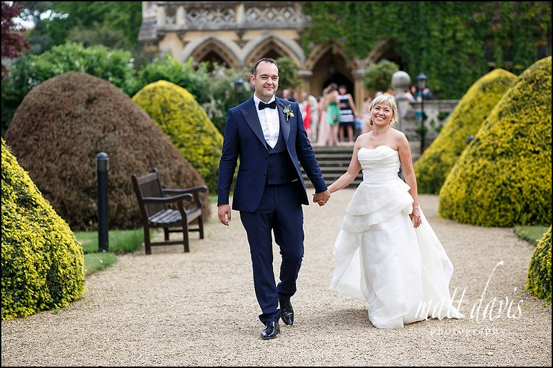 Wedding couple walking in the gardens at Manor By The Lake, Cheltenham