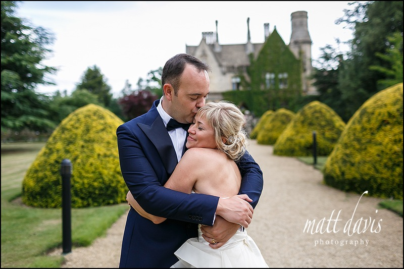 Wedding couple kiss at Manor By The Lake, Cheltenham