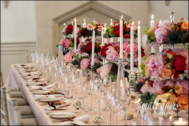 Amazing wedding flowers decorate tables at Manor By The Lake, Cheltenham