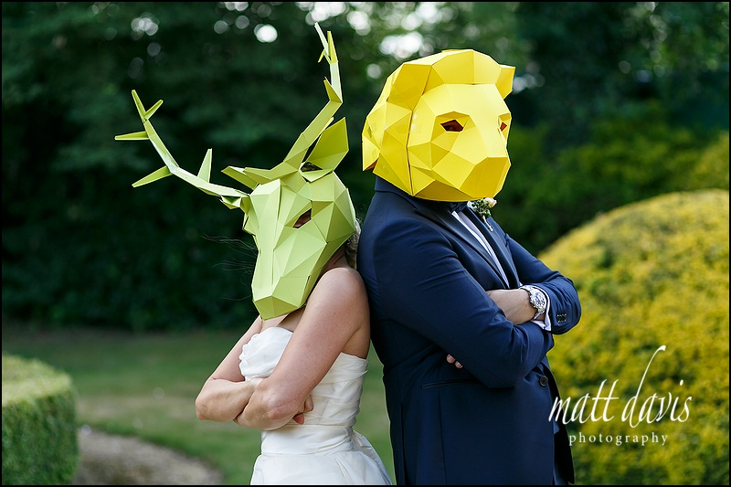 Manor By The Lake wedding with couple wearing cardboard animal masks.