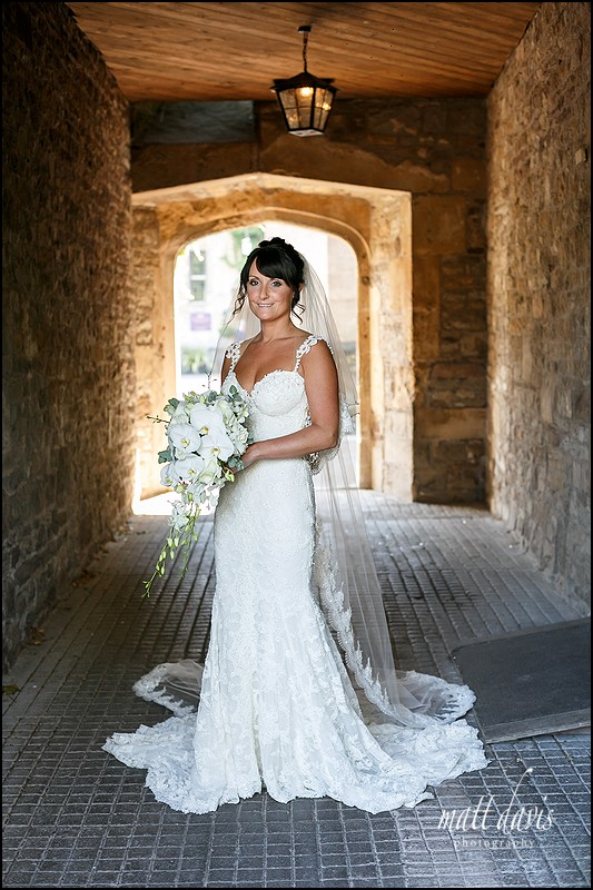 wedding photo with amazing light in the archway at Thornbury Castle, Gloucestershire