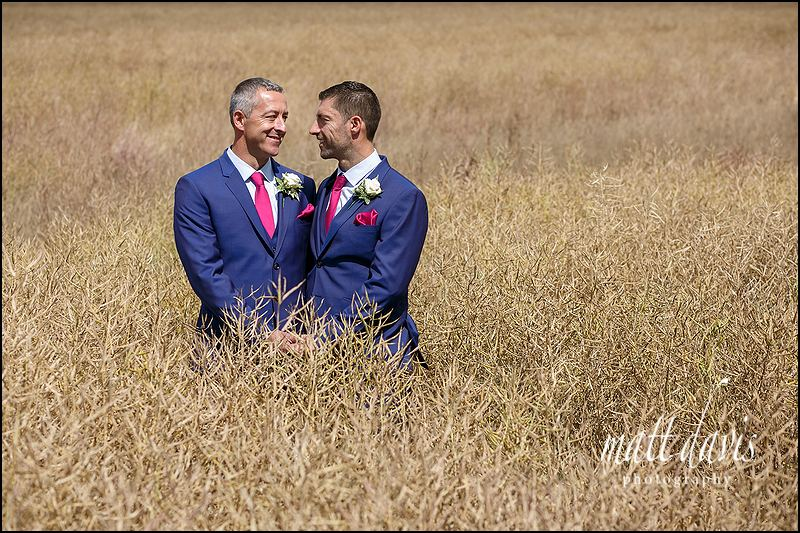 Same sex wedding photograph taken in corn field