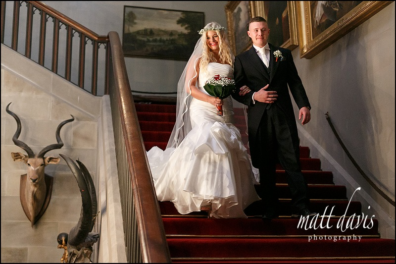 Brides grand entrance on staircase at Eastnor Castle wedding