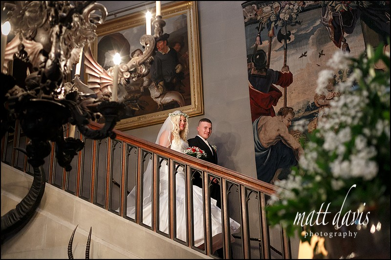 Grand entrance on staircase at Eastnor Castle wedding