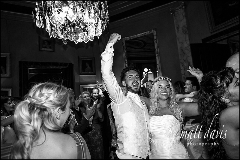 Bride and groom celebrate on the Dance floor at Eastnor Castle Wedding