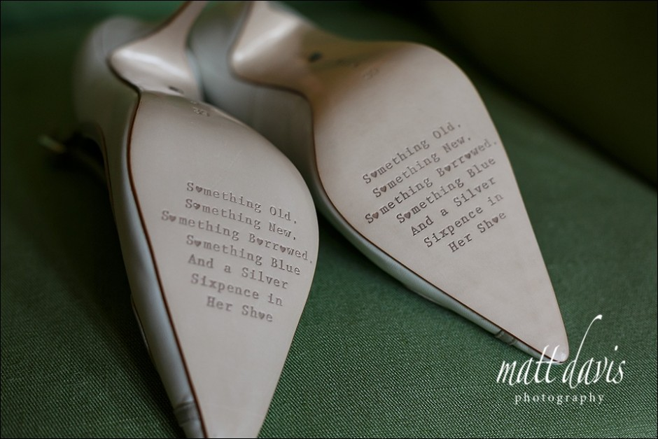 Embossed writing on the bottom of brides wedding shoes.