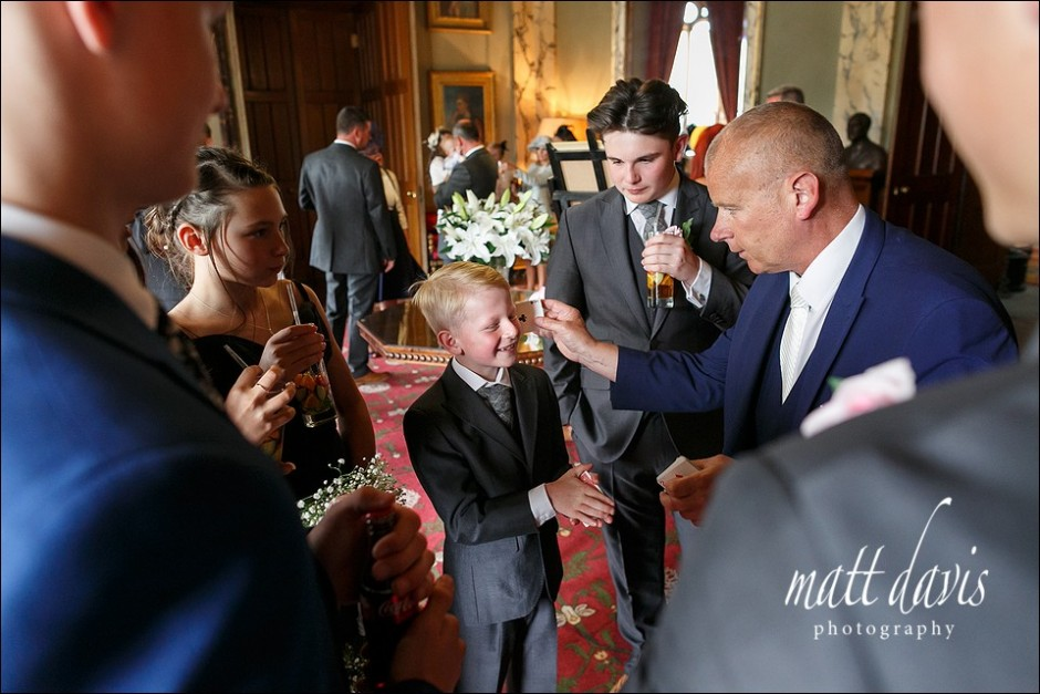 Wedding magician entertaining guests at Eastnor Castle
