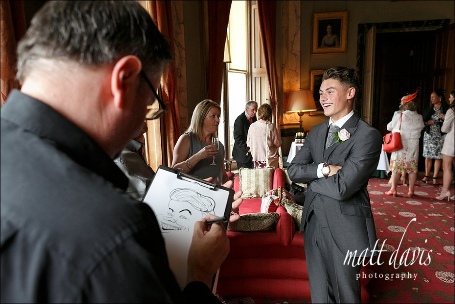 Caricaturist entertaining guests at a wedding at Eastnor Castle