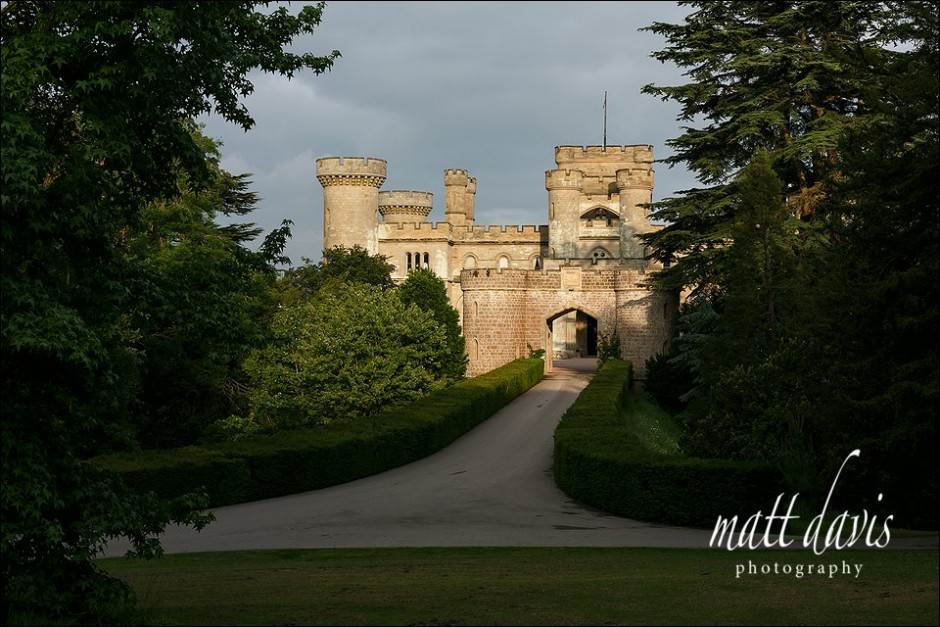 Herefordshire wedding venue Eastnor Castle bathed in golden sunlight.